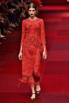 The Prettiest Dresses From Fashion Week #refinery29  http://www.refinery29.com/2014/10/75461/best-dresses-fashion-week-2014#slide17  Lace, fringe, and red all over at Dolce & Gabbana.