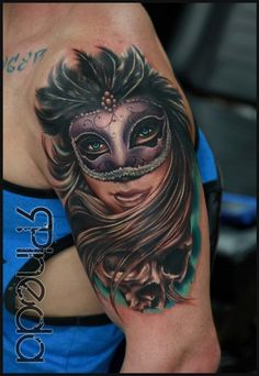 Masquerade mask tattoo.