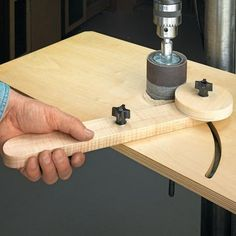"""""""This time of year, I make a lot of toys for family and friends that call for wood wheels. I usually use a hole saw to cut the wheels to size, but that leaves the edges pretty rough. What I needed was an easy way to sand the wheels. My solution is this sanding jig. The jig allows me to sand wheels quickly on a drill press, using a sanding drum attachment""""."""