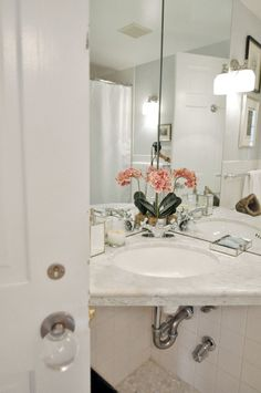 Coppy's Traditional Meets Modern Loft @Twila Starshuk maybe you could do this in your bathroom?  Mirrors in the corners and then do storage above the toilet and nook with a basket of towels underneath the sink?