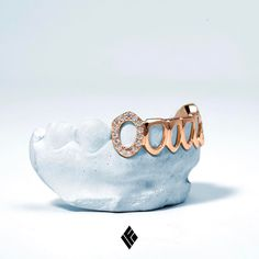 Solid 14k Rose Gold Open Face Diamond Grill with Iced Fangs. Available on www.IFANDCO.com. #Grillz #CustomJewelry #IFANDCO