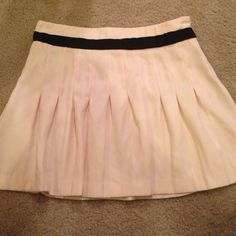 """Cute blush colored pleated skirt Super cute and girly blush/light dusty pink skirt. Has the black """"ribbon"""" around it with a bow up front(hard to se it photos) size small, this is a re-posh, too short for my big booty 😉 Forever 21 Skirts"""