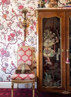 Inside the stunning home of the Ultimate A-list decorator: Alex Papachristidis. The Chinese armoire, found in London, features lacquered panels that add rich contrast to the upholstered walls. Photo by Lesley Unruh. One Kings Lane Designer Houses.