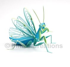 If you are looking for incredibly unique paper quilling designs, then challenge yourself with this Praying Mantis Quilling Art piece. quilling is tough but the results are remarkable. This praying mantis craft fits uncommon paper quilling.