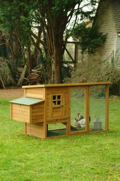 I do not like chickens but I'd consider having them if I had a coop like this one!