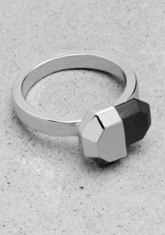 & OTHER STORIES Made from glossy metal, this slender ring is topped with an intriguing angular black stone.