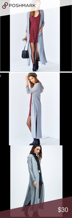 Urban Outfitters Anastasia Long Hooded Cardigan M Slits along the sides. Hooded.front pockets. One pocket has a small unnoticeable tare. Easily fixed. See last pic. Urban Outfitters Sweaters Cardigans