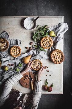 Pear Pecan and Creme Fraiche Mini Pies https://adventuresincooking.com/pear-pecan-creme-fraiche-mini-pies/