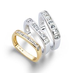 A softened square makes for the most surprisingly comfortable band! 14K gold channel set with a row of crisp white carré cut diamonds in 3 different widths: 2mm stones, 2.5mm stones and 3mm stones. The 2mm band has .44 carat total weight of diamonds. The 2.5mm band has .66 carat total weight of diam