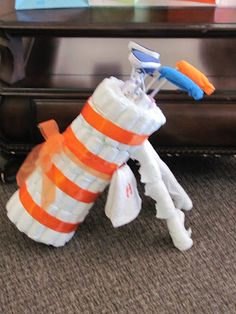 diaper cake/golf bag, golf clubs out of little shoes.  no directions but would be easy enough to figure out