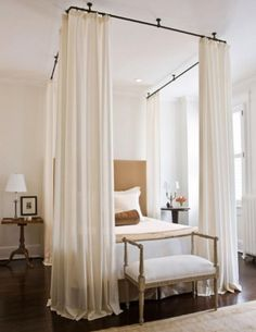 Diff furniture..but cute idea w/hanging curtians, around the bed!