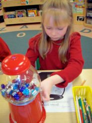 Gumball Sight Words!  Print sight words onto stickers and adhere them with 3 coats of Mod Podge to glass gems.  Kids use pennies to get the gems out, and write them on a gumball machine master.