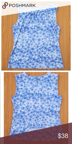 "CALVIN KLEIN blue floral top Brand new Calvin Klein top Sleeveless smooth feel top with a button closure in back. Perfect for a day at the office. 95% polyester  5% spandex  25"" Length  18"" across bust Calvin Klein Tops Blouses"
