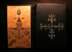 Liber Falxifer III - The Book of the 52 Stations of the Crosses of Nod - 72 copies - Deluxe Edition (2016)  Gold stamped with 'the Grand Esoteric Cross-Seal of the Majesty of the Intersecting Paths of Nod' on the cover.  Handbound in full black goatskin with handmade endpapers, 24 carat gold gilding, black silk ribbon bookmark.  Each grimoire is consecrated and hand numbered with the unified Ensouling Ink of the Kingdoms of Nod and  comes with a Medallion Talisman of Qayin, related to the…