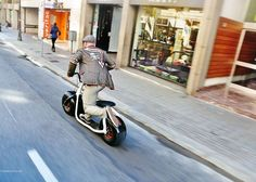 "Electric scooter by Scrooser (j) The Scrooser, developed by a German company of the same name, beat its $120,000 target on the crowd-funding website. The firm will now finalise the design of its ""impulse drive"" motor, which sits within the hub of the rear wheel and delivers a burst of power each time the rider uses their foot to propel the vehicle forward."