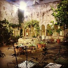 Clifftop location, coastal views & cloistered courtyard at former monastery Hotel Luna Convento in Amalfi Salerno, Italy
