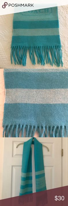 """Coach Two Tone Aqua Scarf This is a Coach two tone aqua colored scarf. It has 3 stripes in the lighter tone on each end and the coach label on one end. It is made of 70% wool and 30% cashmere. It is 62"""" in length excluding the fringe. It has one tiny spot as shown in the last picture that has to do with the weave of the fabric. Coach Accessories Scarves & Wraps"""