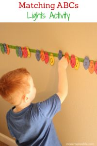 Matching ABCs Christmas Lights Activity for preschoolers. Work on letter identification and letter sounds!
