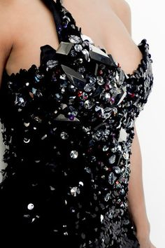 a new twist to the old Sequin Dress!! this is certainly a desginer to look out for