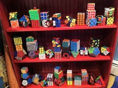colorful Rubik's cube collection - Isaac's dream :). He's on his way and can solve them all!