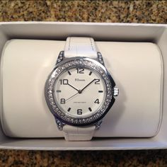 White leather and quartz watch High Quality Genuine Leather Band. Round fashion watch featuring Rhinestons, Classy look. Japan Quartz movement with Analog Display. This watch is WATER RESISTANT up to 99 feet. This watch is simply gorgeous!!! FSteen Jewelry Bracelets