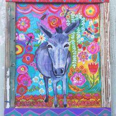 Cute donkey in a handmade frame.