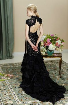 Designer: Martha Medeiros - Brazil Couture. Black lace and feathers are always so trendy!