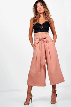 Amelie Pleated Waist Wide Leg Culottes by Boohoo. Trousers are a more sophisticated alternative to skinniesTrousers take on a realxed silhouette for the new season, with sports tailoring setting the trends and the wide leg one to watch. Pick printed palazzo pants for a dramatic day time... #boohoo #pants