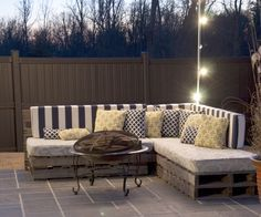 So this is probably one of my favorite pallet projects. It is made of all reclaimed materials: pallets, cushions, pillows, and fabric is almost recla...