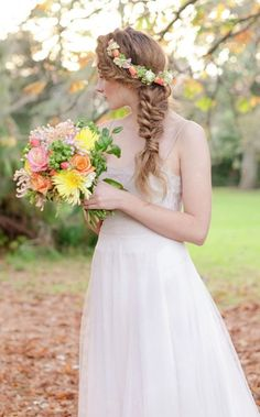 Pretty loose fish tail braid wedding hairstyle with gorgeous flower crown; Featured Photographer: Kate Grewal