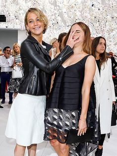 FACE OFF In the battle of Katniss vs. Hermione, we all know who would win now! Jennifer Lawrence shares a silly moment with Emma Watson at the Christian Dior show during Paris Fashion Week on Monday.