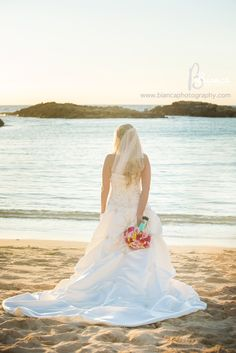 A photograph taken for a Disney bride. This Disney wedding was at Aulani, A Disney Resort & Spa in Ko Olina. on the island of Oʻahu. Hawaiian/ Disney wedding. (It's like the best of both worlds.)