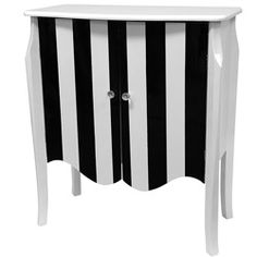 Just the right height for a bedside, lamp or telephone table. Striking black and white high contrast stripes. Both a distinctive decor statement and a practical storage space.