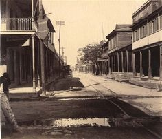 While this shows the Market Exchange at the south-west corner of Duke and    Harbour Streets in Kingston.    These photographs will go under the hammer next week, with an estimated    valeuie for between £3000-5000.   <ul> <li>The auction will take place on December 4. See         here for more information on the auction lot </li> </ul>