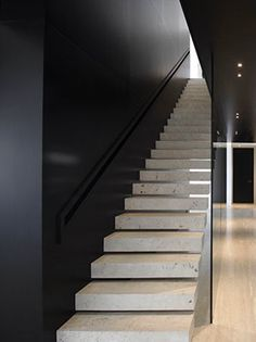 Elegant integrated handrail, interior view of the Travertine House in Madrid by A-cero architects.