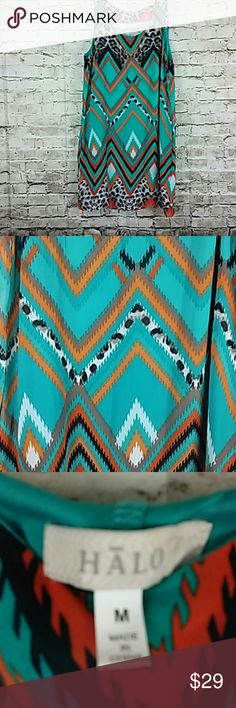 Halo Ladies Aztec Print Sleeveless Dress Sleeveless Multi Color Keyhole Back Pullover Ladies Dress. Chest measures 17 inches. Length measures 37 inches. Gently used.  Thank you for taking a closer look at this item. Please feel free to check out my closet. Halo Dresses Midi