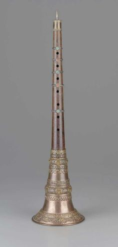 """OBOE   Oboe (rgya-gling)  , 19th century - South Asia.   Gyaling literally meaning """"Indian trumpet"""" is a traditional woodwind instrument used in Tibet. Specifically, it is a double reed shawm used mainly in Tibetan monasteries during puja (chanting and prayer) and is associated with peaceful deities and the idea of devotion.    ."""