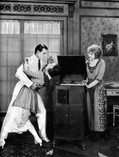 Rudolph Valentino dancing the tango with Alice Terry in a publicity photo for…