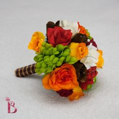 Perfect for fall/autumn weddings! Colorful and fun bouquet with orange, coral red, brown, lime green, yellow and cream silk flowers (roses, buds, mums). (http://www.thebridalflower.com/fall-foliage-style/)