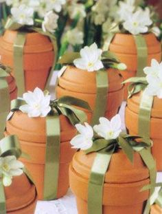 "Packaged Flower Bulbs. Materials: One paper-white Narcissus bulb, One 3""-4"" terra cotta pot with matching saucer, 38"" of 5/8""-wide satin ribbon, One fresh or silk paper-white flower. The varieties Ziva and Galilee are the most reliable. Place bulb in the terra cotta pot and cover with the saucer turned upside-down. As though you are wrapping a package, use the ribbon to tie the pot and saucer together, finishing with a bow on top. Slip a fresh or silk flower under the bow."