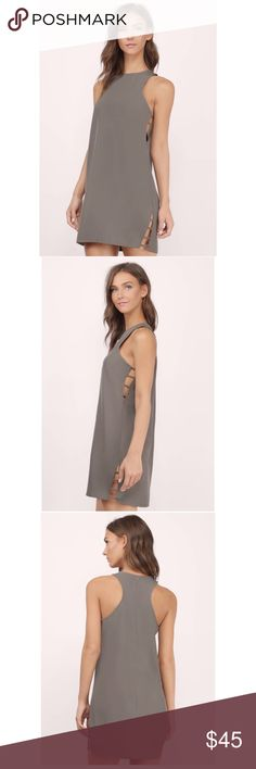 Tobi Dakota Side Strap Shift Dress in Mocha Tobi Dakota Side Strap Shift Dress in Mocha - features a slightly opened side slit with multiple strap detail. Racer back and a relaxed shifty body for an easy silhouette. Pair with heels or sneakers for an edgy look. Tobi Dresses