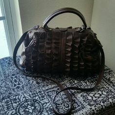 JESSICA SIMPSON. ......UPDATING SOON... ....GREAT CONDITION  ....NORMAL WEAR ....MINOR ..SCUFFS ....GORGEOUS  ....true to its size and color ....color .... brown  ....design...throughout  ....ruffles on front ....ruffles on back ....one hand handle ....shoulder strap  ....logo on sides and bottom ....4 pic...normal wear.. ....better in person Jessica Simpson Bags