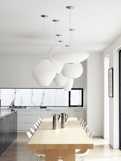 A very industrialized kitchen....dont like the light fixtures .I do like the architecture and mix of metal with wood!