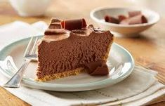 Recipe for Easy No-Bake Chocolate Cheesecake - Creamy chocolate cheesecake in a graham cracker crust, ready in three oven-free steps! (No Bake Chocolate Desserts) No Bake Desserts, Easy Desserts, Delicious Desserts, Dessert Recipes, Yummy Food, No Bake Chocolate Cheesecake, Chocolate Desserts, Hershey's Chocolate Chips, Chocolate Fudge