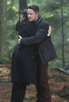 Awesome Regina and Robin hugging in the awesome Enchanted Forest in Storybrooke Maine in an awesome fourth season episode of Once