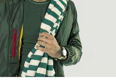 Orologio TIMEX, telo mare MC2 SAINT BARTH, giacca a vento FAY, t-shirt ATHLETIC VINTAGE