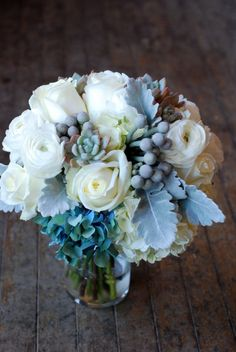 White roses and silver dusty miller bouquet