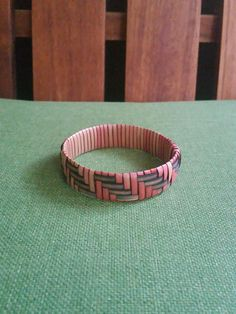 This unique handwoven bracelet was made on the Big Island of Hawaii, using the traditional Hawaiian weaving technique known as lauhala weaving. Woven from the leaves (lau) of the pandanus tectorius (hala) tree, this bracelet measures 9.25 around.