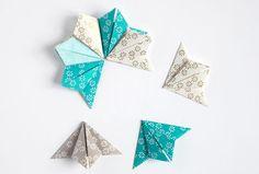 A l'aide de carrés de joli papier (6 x 6 cm)eten moins de 5 minutes, réaliser cette étoile d'ornement à suspendre en origami....