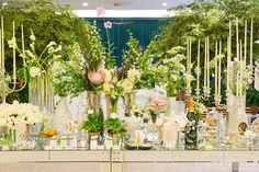 Beautiful dessert and tea table with lots of flowers for a Perrier-Jouët event.
